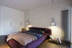 Built under Wall Wardrobe from Poland Apartment Bedroom Among Purple Bed Also Some Colorful Cushions
