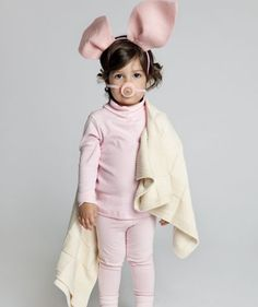 Pig in a Blanket: Start by decking out your little one in pink, head to toe. Add felt ears and a bottle cap/button nose. Wrap her in her favorite blankie and you've got one little piggy way too adorable to stay home.