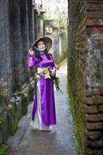 Thiếu nữ Hà Thành trong sắc tím áo dài mùa hoa loa kèn | NgườiĐẹp.Biz