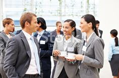 Business People Conversing at a Conference Royalty Free Stock Photo