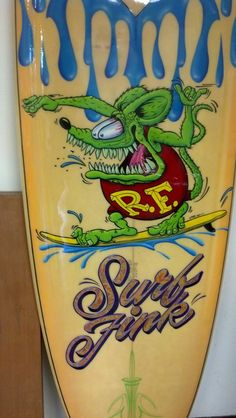 Surfboard with hand painted artwork, Rat Fink, variegated leaf lettering and pinstriping by Geet LN SIGNS 719-648-3058 PO Box 358 Divide, CO 80814 www.lnsigns.com We custom make signs to order and ship anywhere in the US!