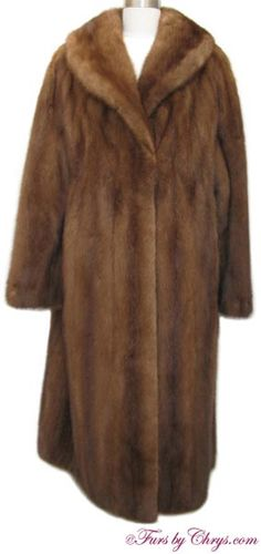 Plus Size Whiskey Mink Fur Coat #WM747; $1500.00; Excellent Condition; Size range: 16 - 20. This is a lovely genuine natural whiskey mink fur coat in a nice, generous size. It has a Fernand Pincince Furs label and features a large shawl collar and straight sleeves. It closes with furrier's locking clasps and there is one hook and eye at the collar. When you wear this gorgeous whiskey mink coat you will feel as enchanting as you look!
