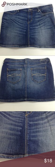 Abercrombie & Fitch Fitted Denim Jean Skirt Fitted, distressed and feathered denim skirt with just a hint of stretch.  Button and zip fly.  Super cute pockets.  Measurements taken lying flat, straight across, in inches.  Waist: 16.5, Length: 12.25.  Material content in last photo. Abercrombie & Fitch Skirts Mini