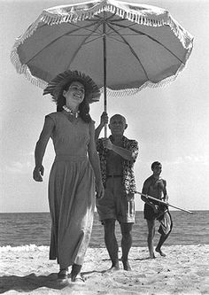 """Picasso and the pretty Francoise Gilot on the Cote d'Azur, cca. 1955.  This one of his many relationships inspired the film """"Surviving Picasso"""" by M. Ivory in the 90's."""