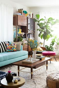 I love the turqouise couch. Colorful livingroom