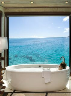 Conrad Bora Bora Nui offers 5 star luxury rooms and suites. Enjoy your stay at this upscale Bora Bora hotel. The Places Youll Go, Places To Go, Hotels, Dream Bathrooms, Outdoor Bathrooms, Beautiful Bathrooms, Spas, Dream Vacations, Vacation Spots