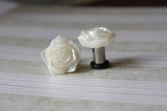 Pearl flower plugs tunnels for gauged / stretched ears: 14g (1.6mm),12g (2mm),10g (2.4mm),8g (3mm),6g (4mm),4g (5mm),2g (6mm),0g (8mm). $14.00, via Etsy.