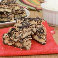 Samoa's Bark  - 1 cup sweetened coconut flakes  - 1 cup sugar  - 2 tablespoons water  - 4 tablespoon butter, cut into ½-inch cubes  - 7 tablespoon heavy cream  - 1 (11.5oz) bag of dark chocolate chips  - 1 cup coarsely crushed shortbread cookies