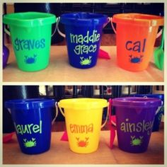 Personalized sand buckets for a family beach trip