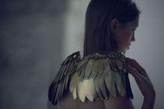 gold angel wing shoulders