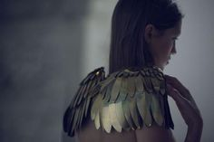 gold angel wing shoulders