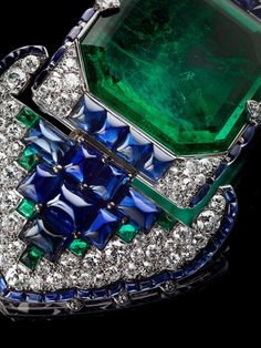 Belt brooch, by Cartier, Paris, 1922, of platinum, set with diamonds emeralds and sapphires