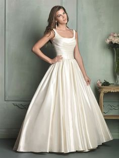 Allure / Regal ballgown is a wealth of decadent satin, draped perfectly throughout the simple silhouette.