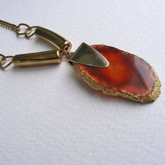 Orange agate pendant upcycle vintage gold colored chain and pieces. $33.00, via Etsy.