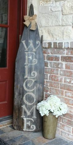 Ironing Board Welcome Sign - 40 Rustic Home Decor Ideas You Can Build Yourself. Maybe a surf board instead of an ironing board?