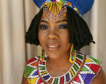 This is the ideal wedding accessories for an African Zulu wedding. It consist of an isicholo (hat) which has a veil, a pair of extra large earrings and large web necklace. It can be worn at carnivals, African festivals and weddings. Zulu Traditional Attire, Zulu Traditional Wedding, Traditional Dresses, African Men Fashion, African Wear, African Dress, African Clothes, African Style, African Design