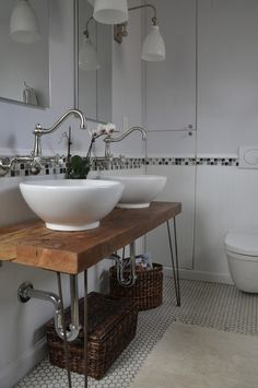 If you're feeling especially hands-on, consider using hairpin legs for a DIY bathroom vanity, like in this image. This pair of vessel sinks looks especially smashing on the hairpin-legged console.