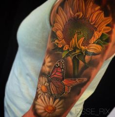 Sweet summery nature sleeve with a sunflower and a butterfly perched on a daisy. This realistic half sleeve was tattooed by Jesse Rix, a tattoo artist based in Keene, New Hampshire.