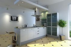 Small white modern kitchen comprised of only one peninsula counter.