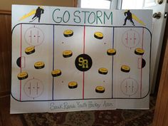 Hockey rink poster with names on pucks for tournament spirit
