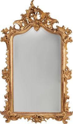 A LOUIS XV-STYLE CARVED GILTWOOD MIRROR, circa 1865.