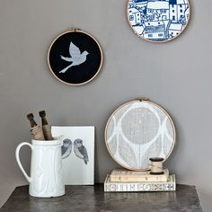 Instead of buying new artwork, use leftover scraps of material to add colour and pattern to a room. Embroidery hoops make ideal frames for fabric scraps