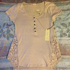 Beautiful Crème Lace Top  Creamy-white shirt with floral lace designs on the side. Brand new, comes with an extra button, goes great with a pair of jeans and flats! Feel free to ask questions/offer!  :) Paper + Tee Tops Tees - Short Sleeve