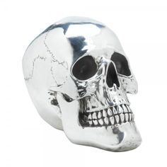 Smiling Silvery Skull Table Top Halloween Decor 10017013 this fantastic smiling skull is the perfect way to add some personality to your room.