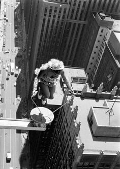 During a performance for a Shriners convention, a Sky Dancer aerialist skips rope on a small platform high (at least 20 stories) above the streets of downtown, Chicago, Illinois, July (Photo by John Dominis/Time & Life Pictures/Getty Images) Black White Photos, Black And White Photography, Life Pictures, Random Pictures, Life Images, Cool Pictures, Life Magazine, Vintage Photography, Art Photography