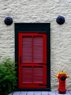 """love there and navy combo and the ornate hurricane anchors.  """"Behind the Red Door"""" from naromeel's photostream on flickr.com"""