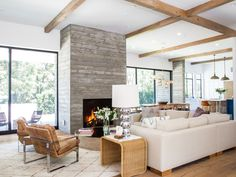 Designer Bryan Wark transformed a Tudor-style property in Los Angeles into this bright, clean-lined home for a family of four. A board-formed concrete fireplace anchors the living room, which features an organic mix of vintage and contemporary pieces, including a 60-inch round mirror from HD Buttercup used as a cocktail table.