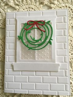 Jls-OPT Christmas Window as cookies, red brick w/flat piping tip in short strips/blocks, wht or brown frame, wht window brackets, panes empty/no icing OR sky blue /etc, wreath as seen or reg.