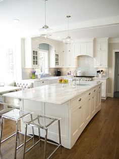 Smaller white kitchen with banquette seating