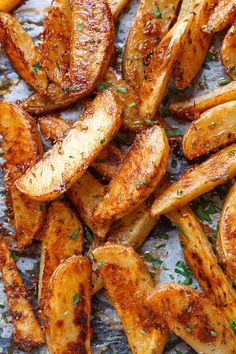 Baked Garlic Parmesan Potato Wedges - Crispy on the outside and tender on the inside, they will blow you away with their simplicity and fantastic flavor!