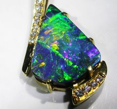 http://www.opalauctions.com/auctions/opal-pendants/gold-opal-pendants/gold-boulder-opal-pendants/item-485508 #opalsaustralia