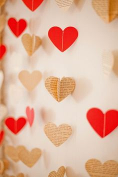 Floating ceremony backdrop with red roses and book page hearts