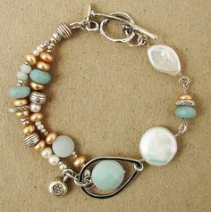"Sterling silver bracelet with Amazonite gemstone & Pearls. Designed in the USA by artisan Ian Gibson of J & I jewelry. Toggle closure. 7.5""L"