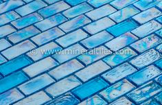Mineral Tiles - Iridescent Pool Glass Tile Pale Blue 1x2, $14.95 (http://www.mineraltiles.com/iridescent-pool-glass-tile-pale-blue-1x2/)