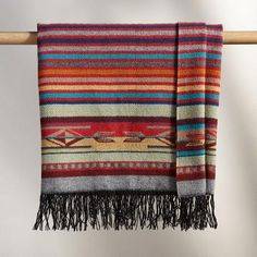 CHIMAYO THROW - With a design inspired by the rich textile traditions of the American Southwest, this vividly colored and beautifully detailed jacquard throw is not only warm and cozy, but a piece of artwork to be cherished.