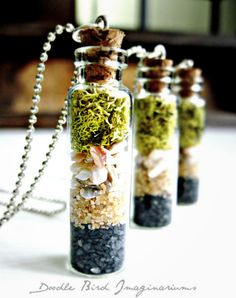 This unique handmade terrarium pendant features layers of sand, crushed shells, and lichen all bottled up inside a miniature glass jar. It is completely care-free. Bottle measures 1.5 high. Necklace/chain not included.  ♥ SHIPPING INFORMATION ♥ All items are handmade and packaged by me and orders are generally processed and shipped in the order they are received. Turn around time is from 7-14 days. Please take a moment to browse my policies page for additional ordering information. •…