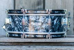 Maple 6&6 with camco-esque edges, wood hoops, & three point throw in old stock black diamond pearl.