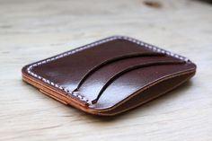 Our 3 Pocket Wallet is made for the card carrying type who is looking for a simple yet beautiful solution to their storage woes. We use a 4 ounce Burgundy Harness leather from the incredible Wickett and Craig tannery out of Curwensville, Pensylvania for this piece. The character of