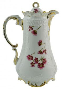 Art Nouveau German tall porcelain coffee or chocolate pot, molded all over with scrolls, floral and gilded decoration, by C.Tielsch 1890s.