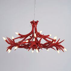 ANTLER CHANDELIERS  Materials: Ceramic with Glass finish Dimensions: 4 Antler: 22 diameter x 24H 6 Antler: 30 diameter x 20H 12 Antler: 40 diameter x 22H 24 Antler: 50 diameter x 28H  Options: White, noir, gold, silver