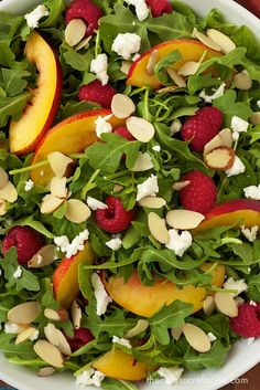 Raspberry Arugula Salad w/ Nectarines, Goat Cheese Toasted Almonds & Raspberry Honey Jalapeño Vinaigrette. The dressing is delicious.