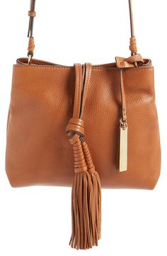 Flouncy tassels add a touch of boho-chic flair to this sleek, pebbled-leather crossbody from Vince Camuto. It also features a roomy interior with enough pockets to keep organized.