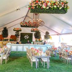And the view towards to bar! Hanging boxwood planters were hanging throughout the tent! They really freshened the setting with a douse of sophistication! #branchingoutevents #flowerbombhorseshoebay #emilyclarkeevents @emilyclarkeevents