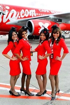 Air Asia enterprising female cabin crew who identified and captured two wanted diamond smugglers on board Flight AA910 from Singapore to Penang. Senior stewardess Angela Soolung (far right) was the first to become suspicious, when the men refused to use the overhead lockers for their hand luggage. Eventually Angela and stewardess Mei Ling (far left) insisted the bags be stored correctly . A struggle over the cases resulted with eventually uncut diamonds cascading down the aisle. While Angela…