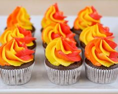 These little cupcakes look a little bit like they're on fire, but the cool striped swirl effect they have is really fun, and really easy to ...