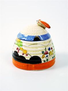 A Clarice Cliff Bizarre `Tulips` beehive Honey Pot and Cover, c.1934, printed mark, 7cm